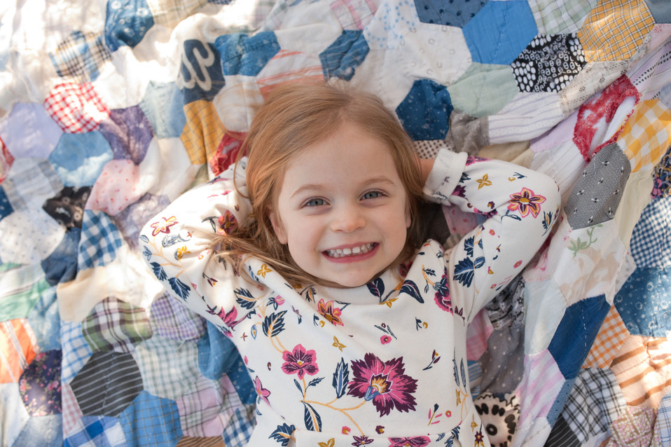 outdoor vintage quilt golden hour family session girl birthday