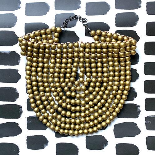gold wood bead collar