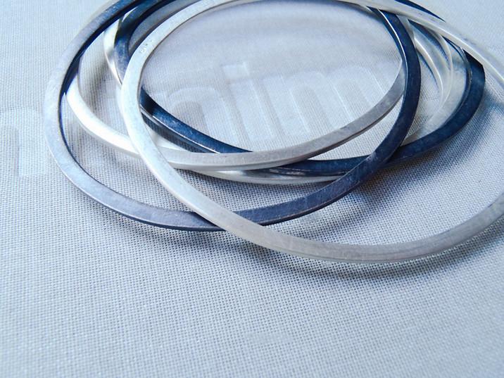 brazaletes ovales planos plata negra y mate