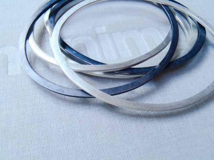 flat oval bangles black and brushed matte silver
