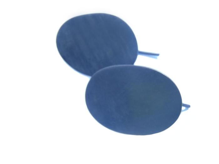 aretes ovales pavonados