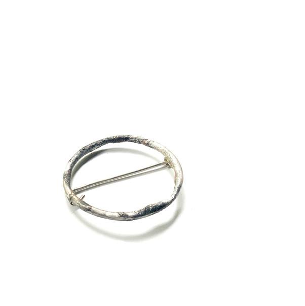 broche circular rústico