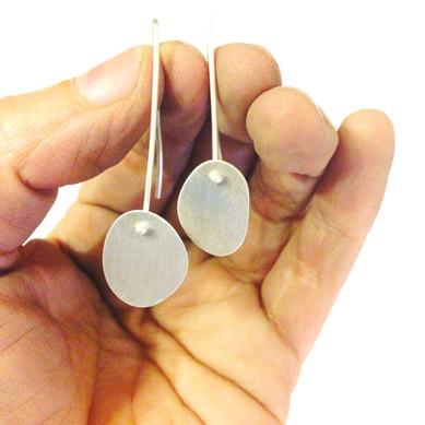 flat oval asymmetric earrings