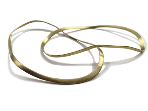 Irregular flat bracelets in brass