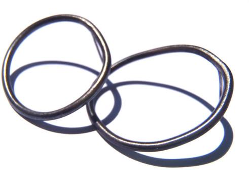 aretes círculos irregulares asimétricos pavonados