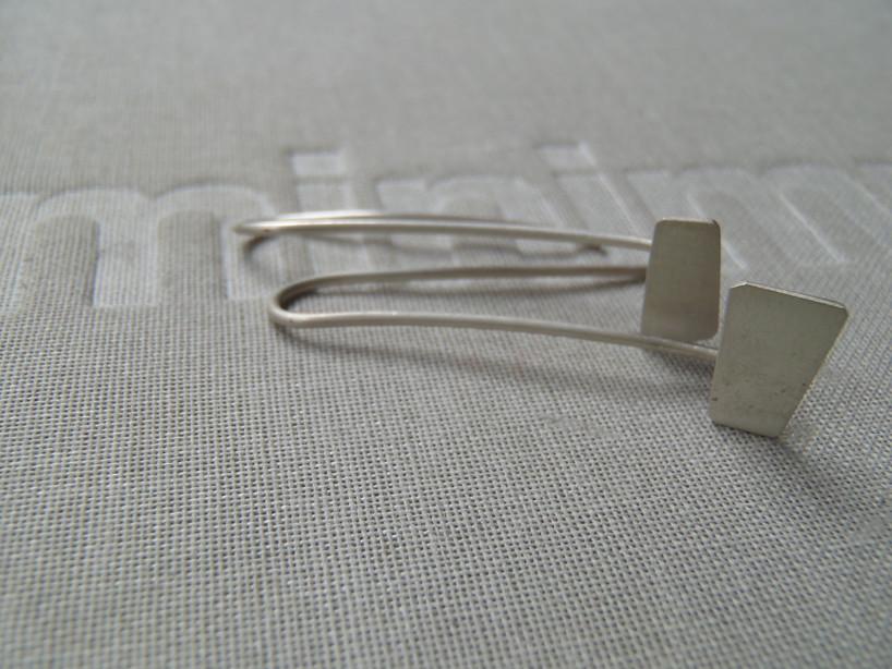 polygon silhouette hook earrings