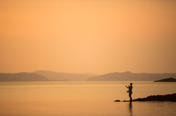 Fliegenfischer Sonnenuntergang