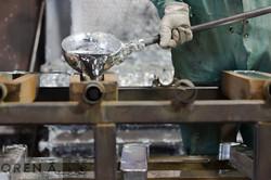 Pouring Zinc into Molds