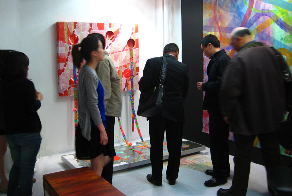 All pieces of artist surounding the space in 2009, New York.  At the background, Please Don't, Three-dimensional painting-installation, mixed media, light and sounds, 80 x 90 x 50 inches.   New York City, 2009 From The Restricted Silent Feelings, and The Celebration of The Ones Allowed