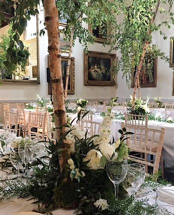 White and green woodland wedding centrepieces