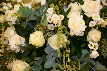 Loose and natural ivory and green wedding flowers