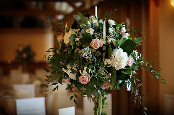 Pink and white floral centrepiece with foliage