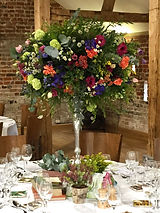Tall multicoloured wedding centrepiece