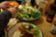 Shared vegan meal around long table