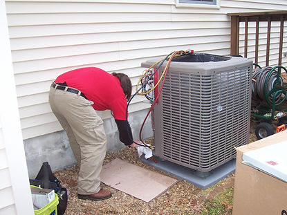 Tech working on an outside unit