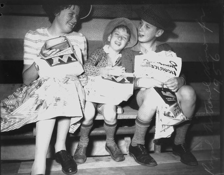 Three children enjoying their sample bag