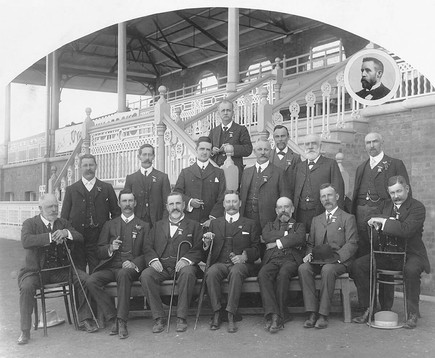 Group of unidentified men pose for a pic