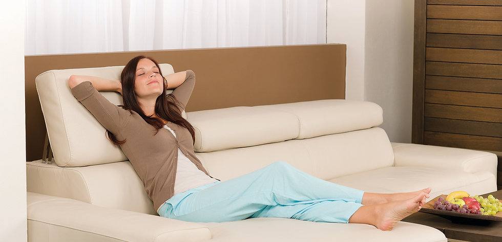 woman taking a break and relaxing on her couch