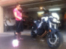 Lady easily cleaning motorcycle