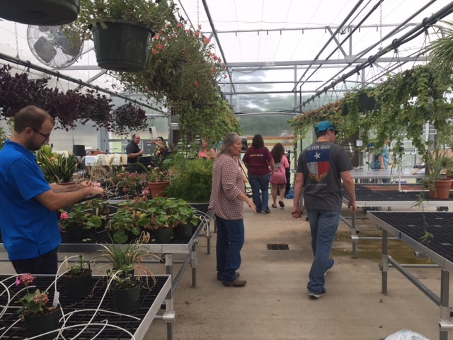 """Instructors participated in a greenhouse maintenance """"scavenger hunt"""" to identify risks that decrease structure longevity."""