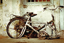 bigstock-old-broken-bike-26064467.jpg