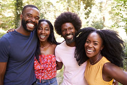 Portrait of four black adult friends on