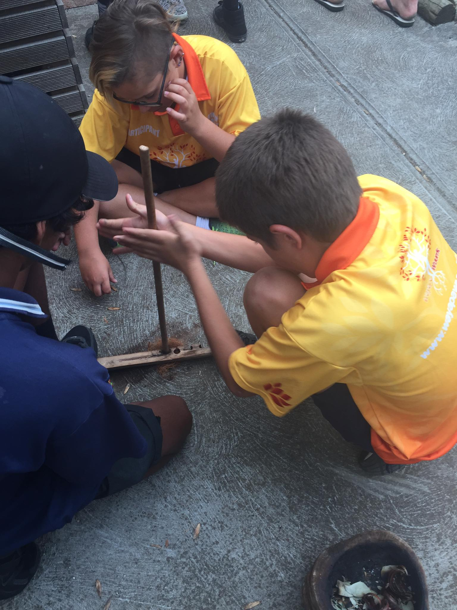 Aboriginal boys lighting fire traditionally