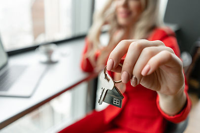 Mortgage concept. Woman in red coral bus