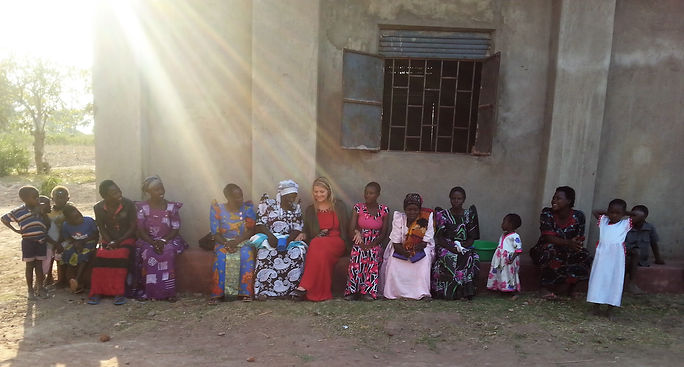 Cindy sitting with Uganda women.jpg