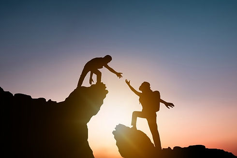 silhouette-people-helping-other-hiker-cl