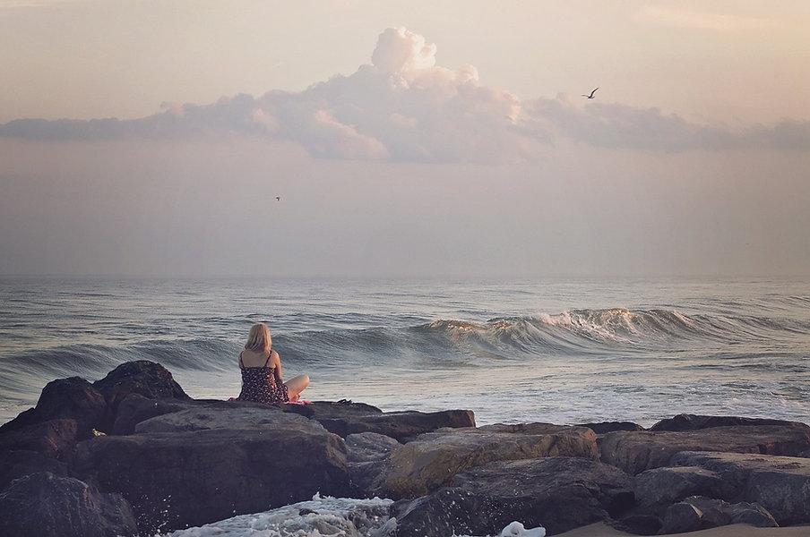 girl on rock on beach.jpg