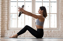 Sporty woman doing pilates toning exerci