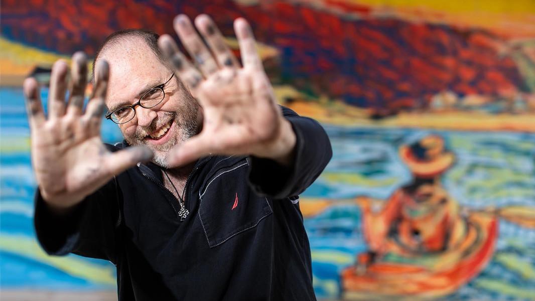 Todd Pinkham with mural.jpg