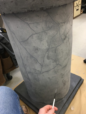 Painting marble pattern on plinth for Beauty and the Beast production