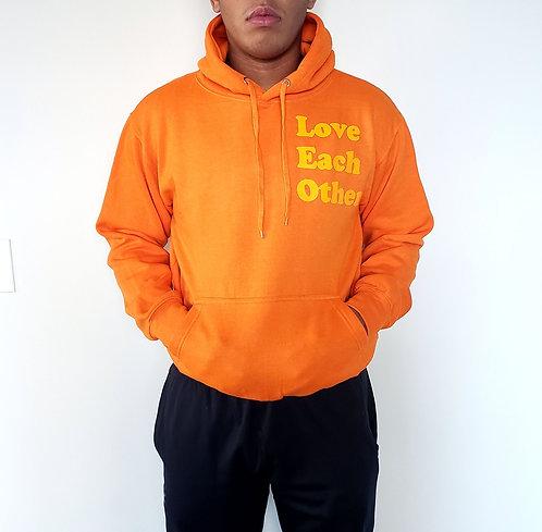 Love Each Other orange hoodie