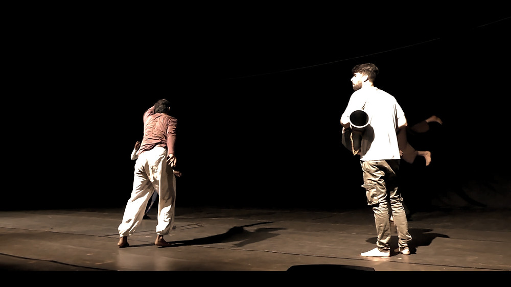 Dancers Improvising with a musician playing darabuka on stage live in India