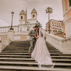 Young wedding couple on Spanish stairs i