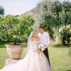 Wedding couple in the garden. The groom