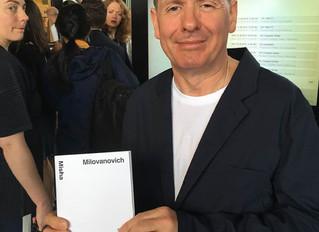 Jim Lambie at Art Basel, 2019 with Misha's book.