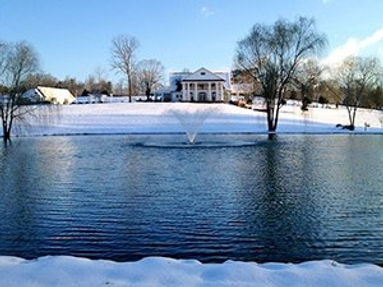 winter pond, lake with aerating fountain display in Canada that are easy to install