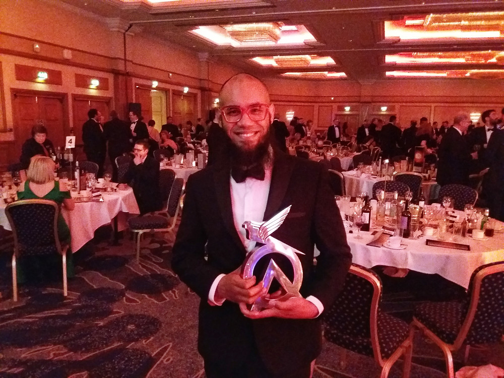Janan Choudhury hoisting the award for Best Fashion Practice at the Optician Awards.