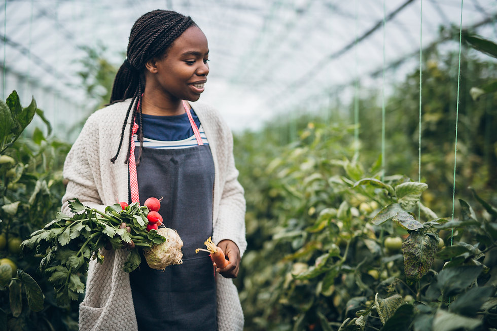 Black woman in greenhouse.jpg