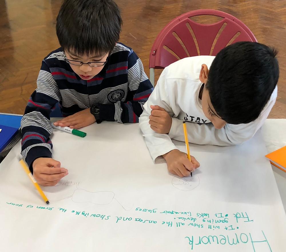 Children designing a robot invention