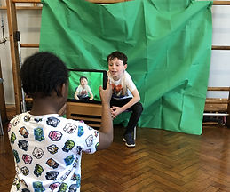 Boys recording movie in extracurricular