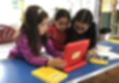 Girls doing collaborative app design on