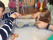 Children making machines in workshop.JPG