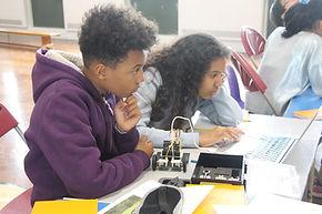 Children building and programming robots