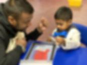 Father & Son creating STEM activity.jpg