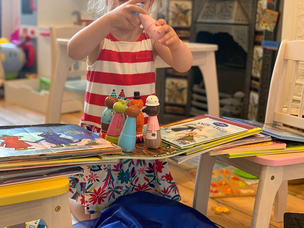 child building bridge from books