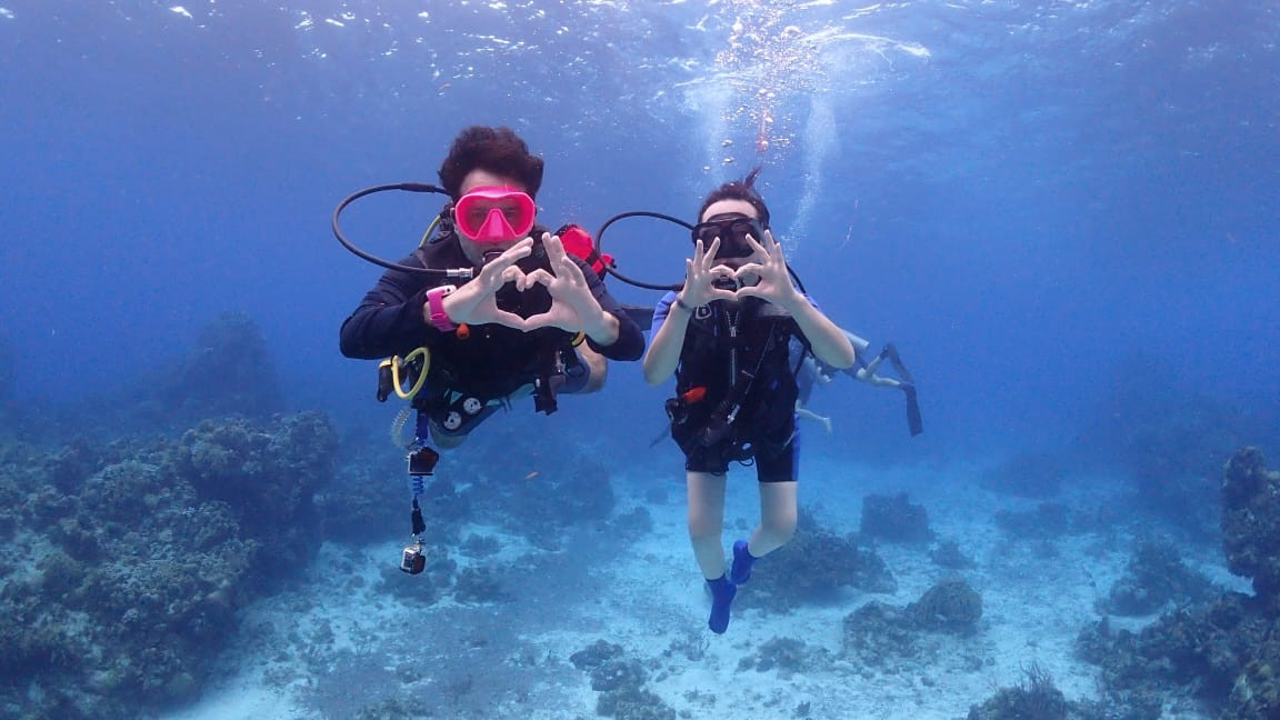 2 divers and reef.jpg